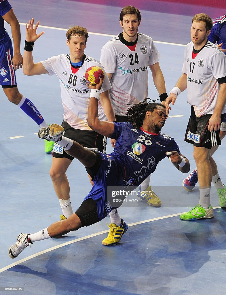 France's pivot Cedric Sorhaindo (C) shoots the ball during the 23rd Men's Handball World Championships preliminary round Group A match France vs Germany at the Palau Sant Jordi in Barcelona on January 18, 2013. Germany won 32-30. AFP PHOTO/ JOSEP LAGO