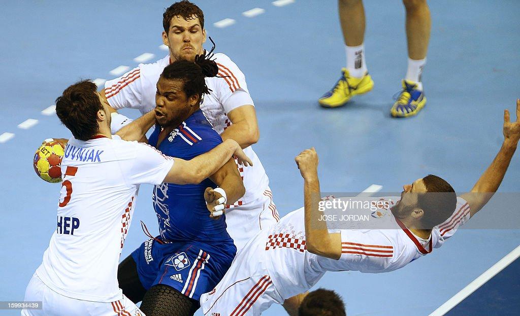 France's pivot Cedric Sorhaindo vies with Croatia's centre back Domagoj Duvnjak Croatia's left back Jakov Gojun Croatia's pivot Zeljko Musa and...