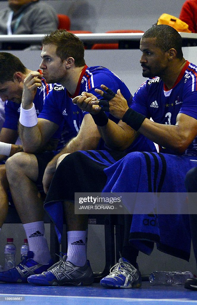 France's pivot Didier Dinart (R) and France's left back William Accambray react during the 23rd Men's Handball World Championships quarterfinal match France vs Croatia at the Pabellon Principe Felipe in Zaragoza on January 23, 2013. Croatia won 30-23.