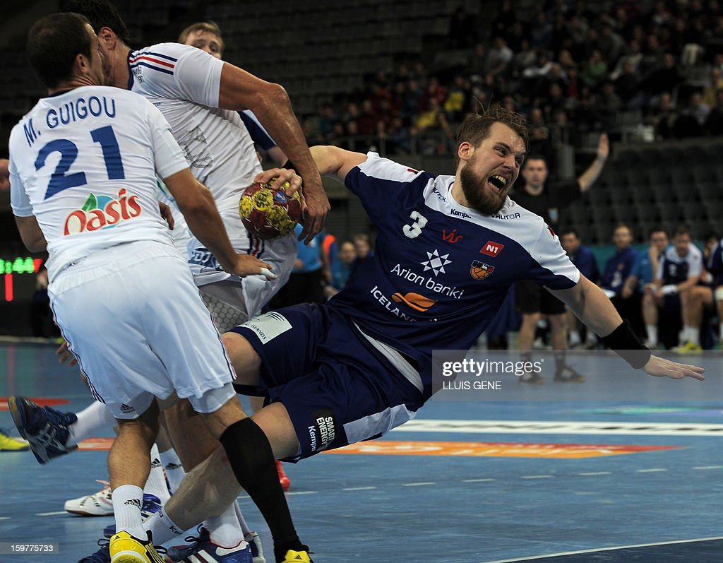 France's pivot Didier Dinart (L) vies with France's centreback Nikola Karabatic (C) and France's leftwing Michael Guigou (L) during the 23rd Men's Handball World Championships round of 16 match Iceland vs France at the Palau Sant Jordi in Barcelona on January 20, 2013.