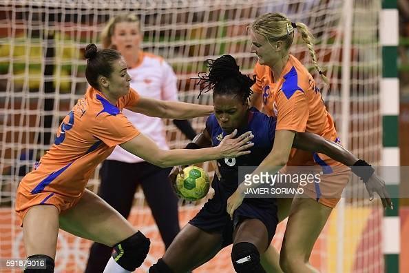 TOPSHOT France's pivot Laurisa Landre vies with Netherlands' left wing Martine Smeets and Netherlands' left back Kelly Dulfer during the women's...