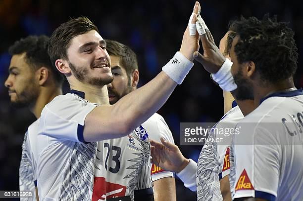 France's pivot Ludovic Fabregas celebrates after winning the 25th IHF Men's World Championship 2017 Group A handball match Japan vs France on January...