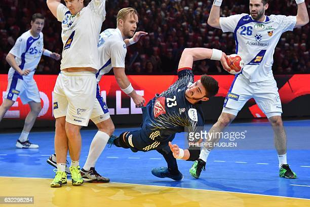 TOPSHOT France's pivot Ludovic Fabregas jumps to shoot on goal during the 25th IHF Men's World Championship 2017 eighth final handball match France...