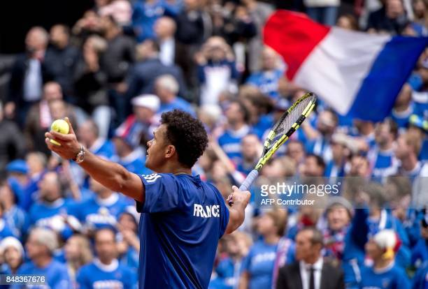 TOPSHOT France's player JoWilfried Tsonga celebrates after winning the Davis Cup World Group semifinal tennis match against Serbia at The Pierre...
