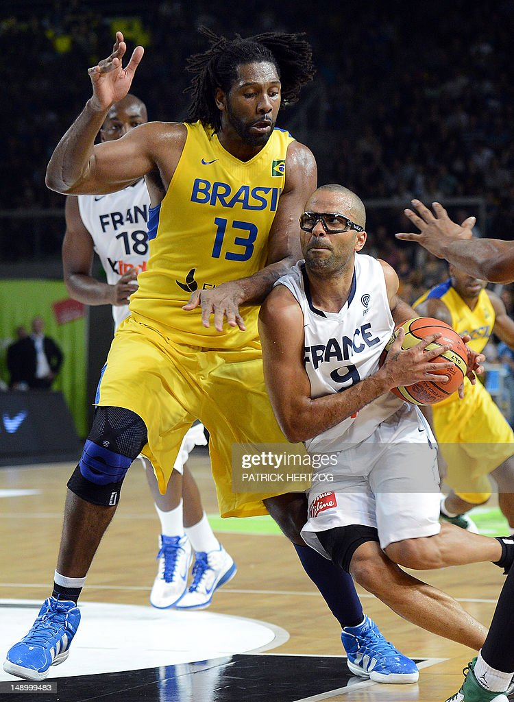 France's player Tony Parker (R) vies with Brazil's player Nene Hilario during the basketball match France vs Brazil, in Strasbourg, eastern France, on July 21, 2012 as part of the preparation for the London 2012 Olympics.