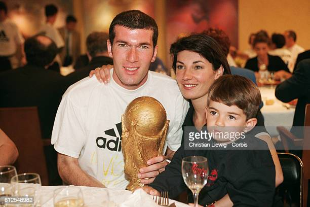 France's players are received at the French soccer federation after their 30 victory over Brazil in the final of the 1998 FIFA World Cup Zinedine...