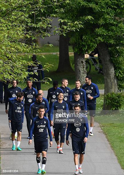 France's players arrives for a training session in Clairefontaine en Yvelines on May 26 as part of the team's preparation for the upcoming Euro 2016...
