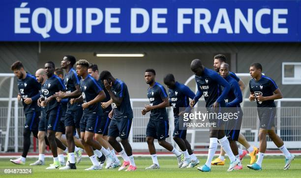 France's players attend a training session in ClairefontaineenYvelines near Paris on June 11 two days before a friendly football match against...