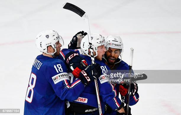 France's players celebrate a goal during the IIHF Men World Championship group B ice hockey match Finland vs France on May 7 in Paris / AFP PHOTO /...