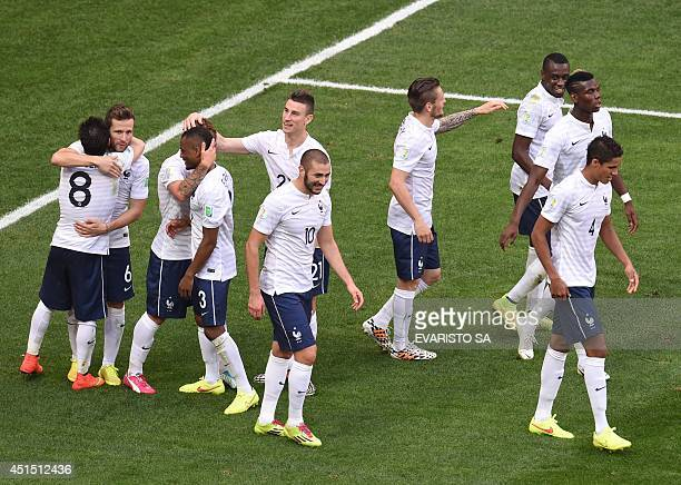 France's players celebrate after a Round of 16 football match between France and Nigeria at Mane Garrincha National Stadium in Brasilia during the...