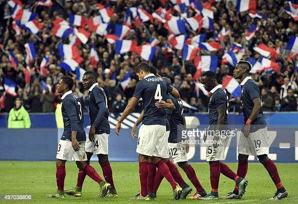 France's players celebrate after opening the scoring during a friendly international football match between France and Germany ahead of the Euro 2016...
