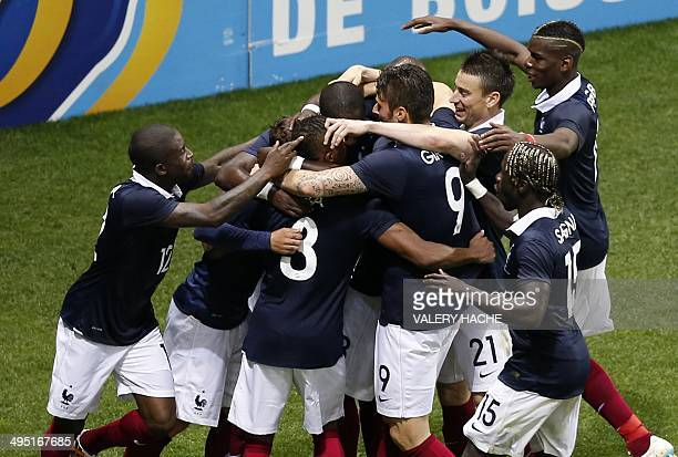 France's players celebrate after scoring a goal during the international friendly football match France vs Paraguay on June 01 at the 'Allianz...