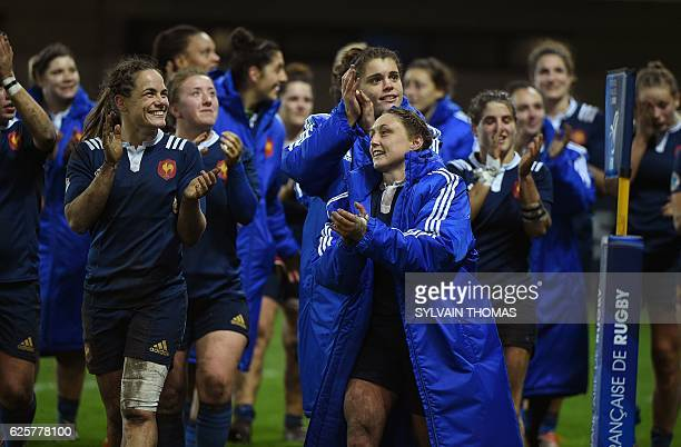 France's players celebrate after the winning the women's rugby union Test match between France and USA at the Altrad Stadium in Montpellier southern...