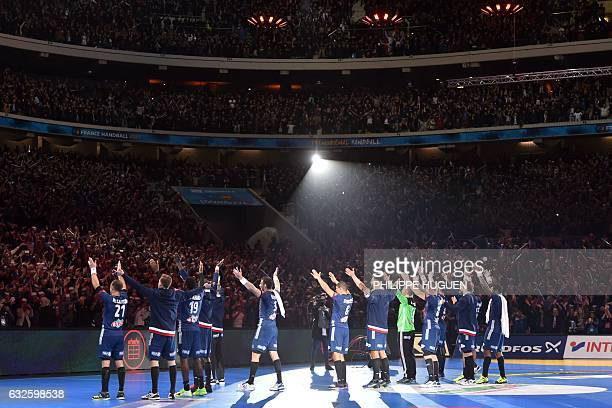 TOPSHOT France's players celebrate after winning the 25th IHF Men's World Championship 2017 quarter final handball match France vs Sweden on January...