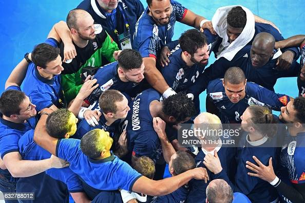 TOPSHOT France's players celebrate after winning the 25th IHF Men's World Championship 2017 semifinal handball match France vs Slovenia on January 26...