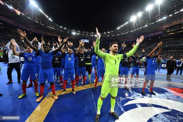 France's players celebrate after winning the FIFA World Cup 2018 qualification football match between France and Belarus at the Stade de France in...