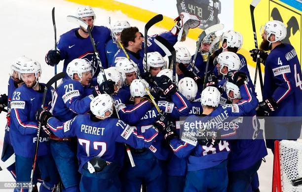 France's players celebrate after winning the IIHF Men's World Championship group B match between Finland and France on May 7 in Paris / AFP PHOTO /...