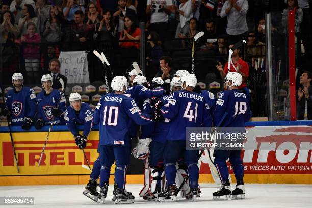 France's players celebrate after winning the IIHF Men's World Championship group B ice hockey match between France and Slovenia on May 15 2017 in...