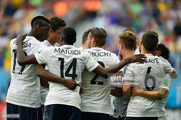 France's players celebrate France's second goal during a Round of 16 football match between France and Nigeria at Mane Garrincha National Stadium in...