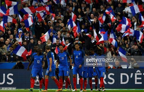 France's players celebrate scoring during the international friendly football match between France and Russia at the Stade de France in SaintDenis...