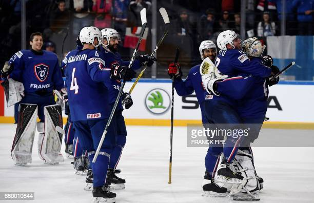France's players celebrate their victory after winning the IIHF Men's World Championship group B match between Finland and France on May 7 in Paris /...