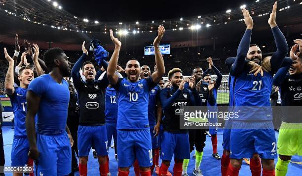 France's players celebrate their victory against Belarus at the end of the FIFA World Cup 2018 qualification football match between France and...