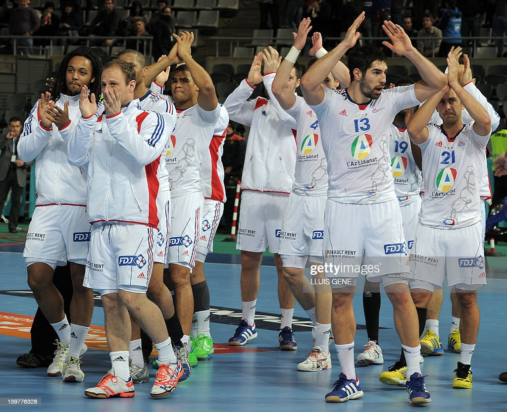 France's players celebrate their victory at the end of the 23rd Men's Handball World Championships round of 16 match Iceland vs France at the Palau Sant Jordi in Barcelona on January 20, 2013. France won 30-28. AFP PHOTO/ LLUIS GENE