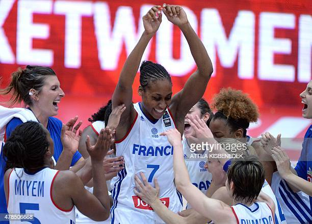 France's players celebrate their victory over Russia after the final round basketball match between France and Russia of the EuroBasket Women 2015...