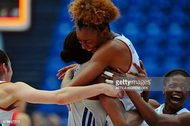 France's players celebrate their victory over Spain after a semi final basketball match of the EuroBasket Women 2015 tournament in SYMA sports hall...