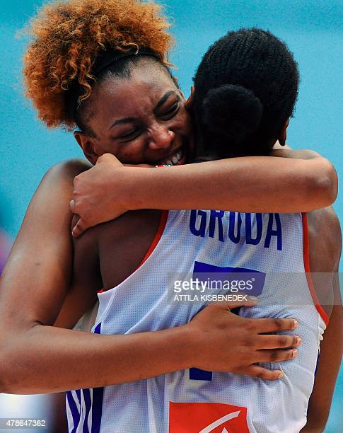 France's players Diandra Tchatchouang and Sandrine Gruda celebrate their victory over Spain after a semi final basketball match of the EuroBasket...