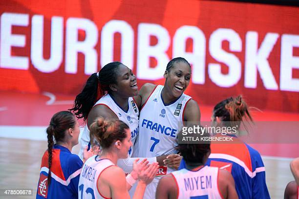 France's players Isabelle Yacoubou and Sandrine Gruda celebrate their victory over Russia with their teammates after the final round basketball match...
