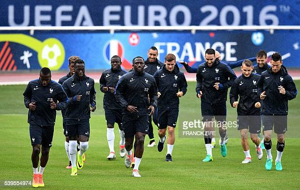 France's players jog during a training session in ClairefontaineenYvelines on June 12 2016 during the Euro 2016 European football championships / AFP...