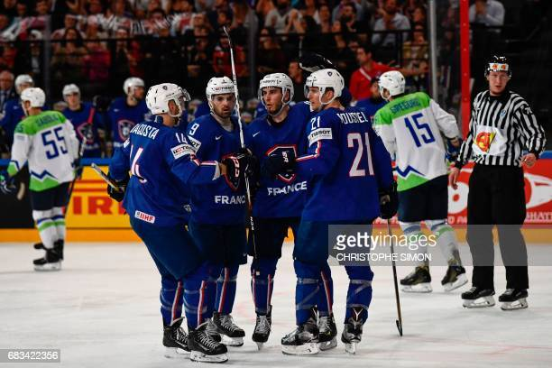 France's players react after France's defender Yohann Auvitu scored during the IIHF Men's World Championship group B ice hockey match between France...