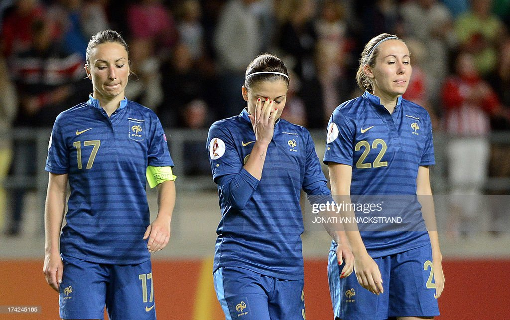 France's players react after losing in the penalty shootout of the UEFA Women's European Championship Euro 2013 quarter final football match France vs Denmark on July 22, 2013 in Linkoping, Sweden.