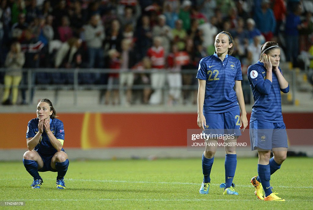 France's players react after losing in the penalty shootout of the UEFA Women's European Championship Euro 2013 quarter final football match France vs Denmark on July 22, 2013 in Linkoping, Sweden. AFP PHOTO/JONATHAN NACKSTRAND