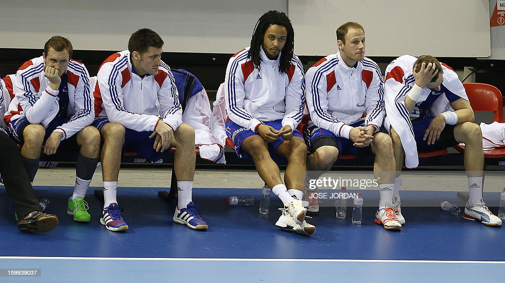 France's players react on the bench during the 23rd Men's Handball World Championships quarterfinal match France vs Croatia at the Pabellon Principe Felipe in Zaragoza on January 23, 2013. Croatia won 30-24.