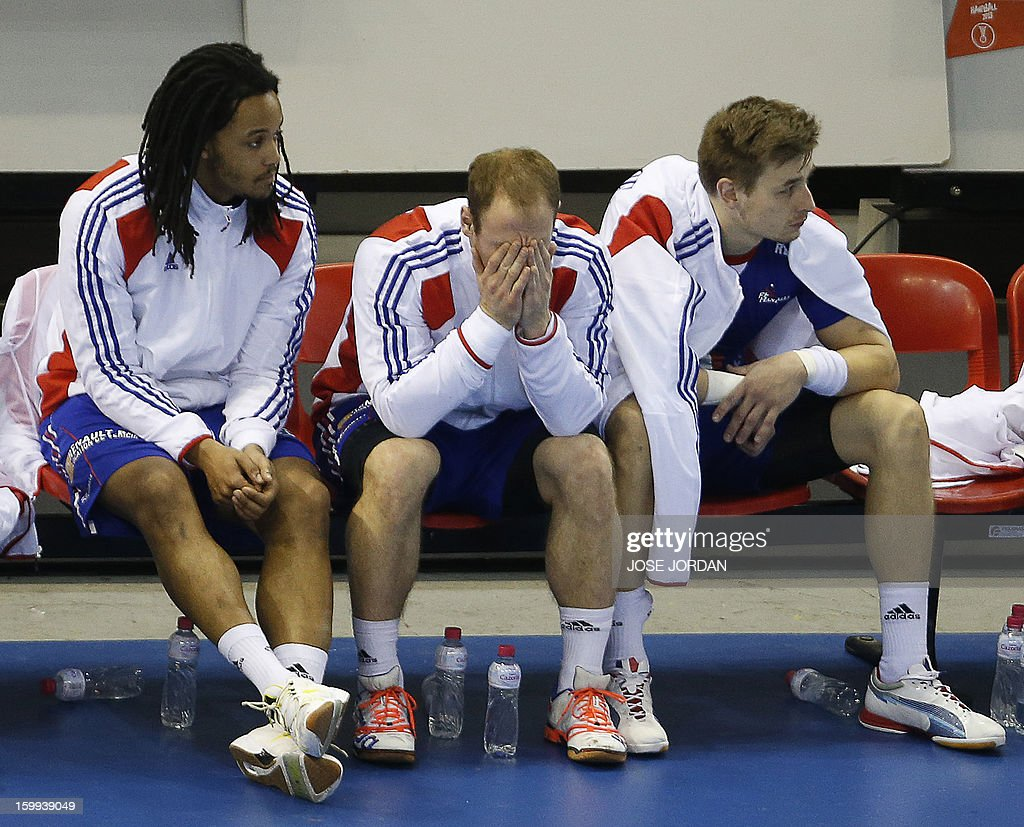 France's players react on the bench during the 23rd Men's Handball World Championships quarterfinal match France vs Croatia at the Pabellon Principe...
