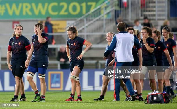 France's players react to defeat after the Women's Rugby World Cup 2017 semifinal match between England and France at The Kingspan Stadium in Belfast...
