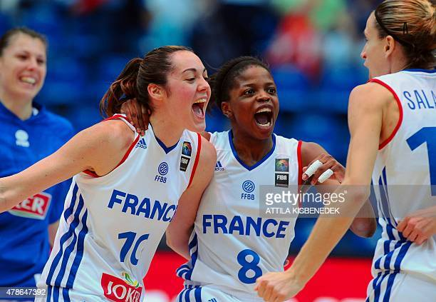 France's players Sarah Michel Olivia Epoupa and Paoline Salagnac celebrate their victory over Spain after a semi final basketball match of the...