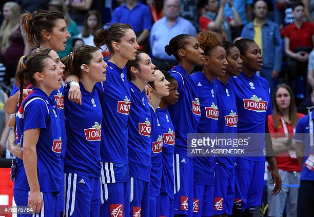 France's players sing their national anthem prior to the final basketball match between France and Serbia of the EuroBasket Women 2015 tournament in...