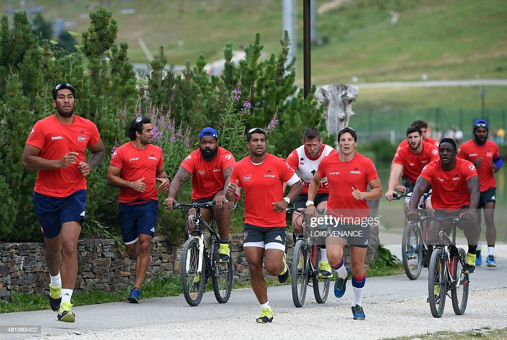 France's players take part in a 'Run and Bike' session as part of the French rugby union team's training camp in Tignes southeastern France on July...