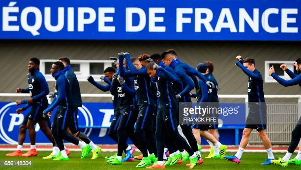 TOPSHOT France's players take part in a training session in Clairefontaine near Paris on March 21 as part of the team's preparation for the upcoming...