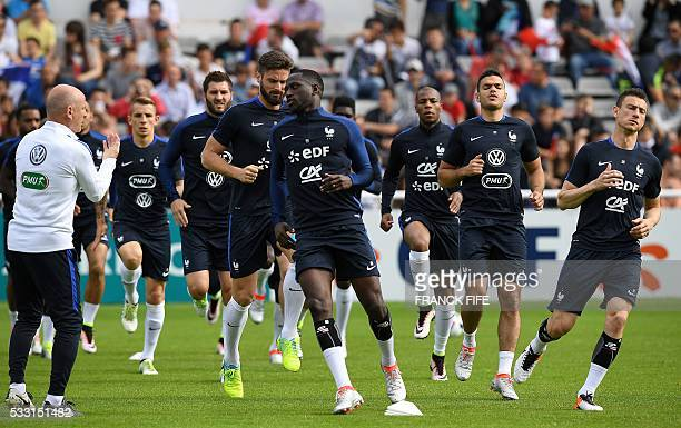 France's players warm up ahead of the friendly football match between French national football team and Bayonne at the Aguilera stadium in Biarritz...