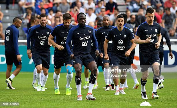 France's players warm up before a friendly match between French national football team and Bayonne at the Aguilera stadium in Biarritz on May 21 as...