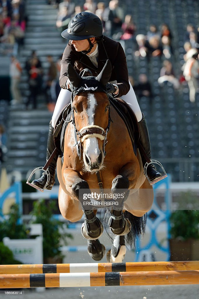 France's Pénélope Leprevost riding Nice Stéphanie competes in the International Jumping Competition 'Grand Prix Hermes' on April 14, 2013, at the Grand Palais in Paris.
