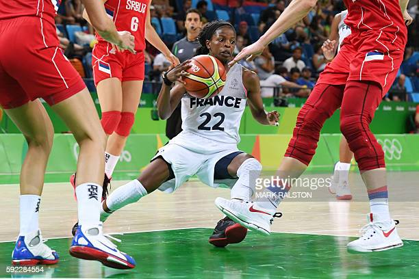 TOPSHOT France's point guard Olivia Epoupa falls during a Women's Bronze medal basketball match between France and Serbia at the Carioca Arena 1 in...