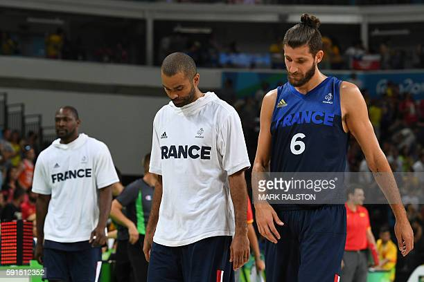 France's point guard Tony Parker and France's point guard Antoine Diot leave the court after losing the Men's quarterfinal basketball match between...