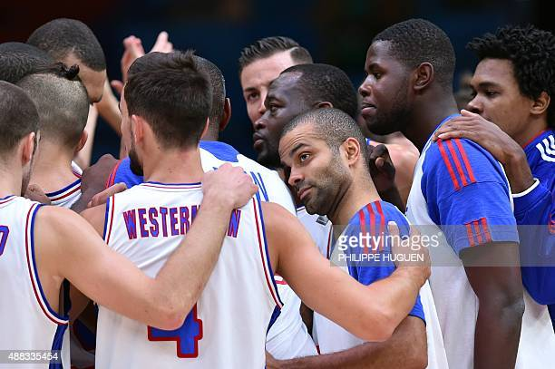 France's point guard Tony Parker and his teammates celebrate after France defeated Latvia in their round of 8 basketball match at the EuroBasket 2015...