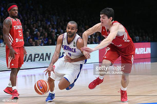 France's point guard Tony Parker dribbles past Turkey's small forward Cedi Osman during the round of 16 basketball match between France and Turkey at...