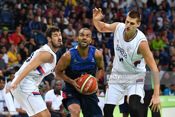 France's point guard Tony Parker eyes the basket during a Men's round Group A basketball match between Serbia and France at the Carioca Arena 1 in...